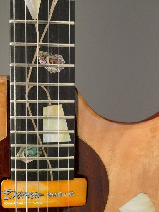Inlays Extend to Fingerboard